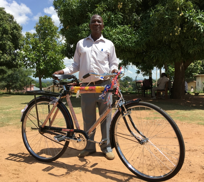 Arua, Uganda. Nyai Sami one of one of the HUMC chairperson from Vurra sub-county with his new bicycle